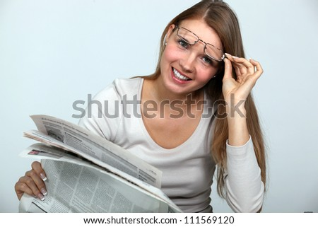 Woman reading the newspaper. - stock photo