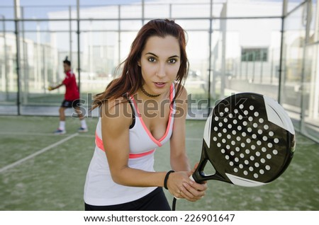 Woman ready for play paddle tennis in outdoors court