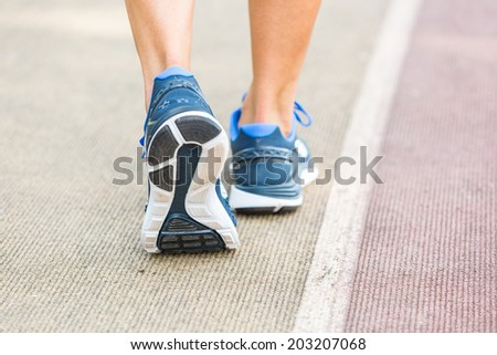 Woman Ready to Run on Track Lane