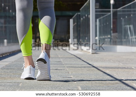 Woman ready to run outdoor, sport in the city in a sunny day