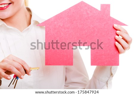 Woman real estate agent holding red paper house and keys. Property business and accommodation or home buying ownership concept, isolated on white background - stock photo