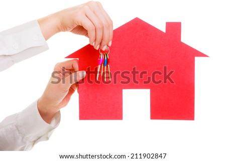 Woman real estate agent holding red paper house and keys. Property business and accomodation or home buying ownership concept, isolated on white background