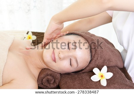 Woman receives massage at spa salon