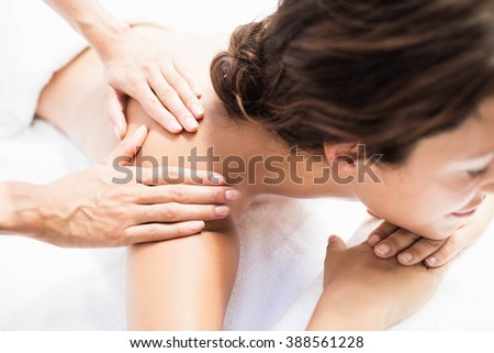 Woman receiving a back massage from masseur in a spa - stock photo