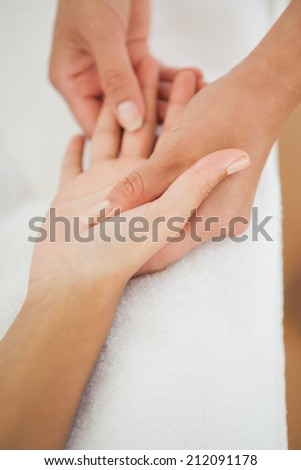 Woman receiving a hand massage at the health spa - stock photo
