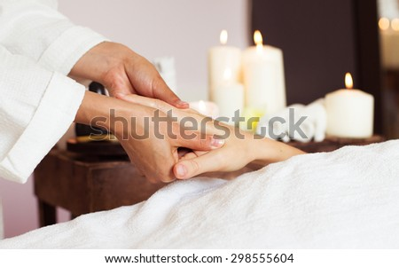 Woman receiving a hand massage at the health spa. Close-up - stock photo
