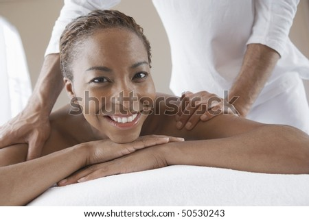 Woman Receiving a Massage, head and shoulders - stock photo