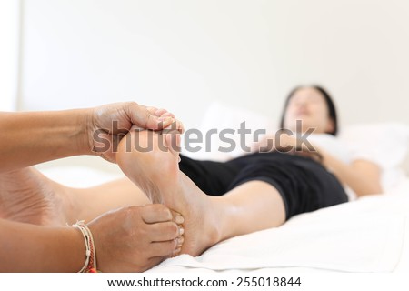 Woman receiving and relaxing foot massage at the health spa