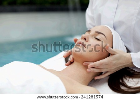 Woman receiving spa treatment - stock photo