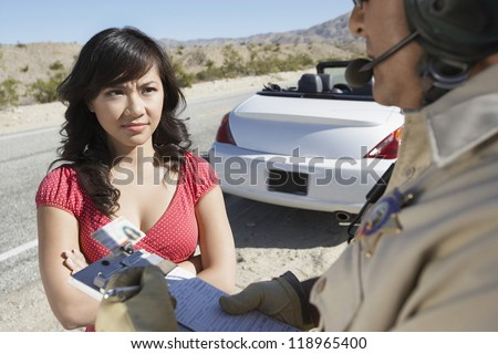 Woman Receiving Speeding Ticket - stock photo