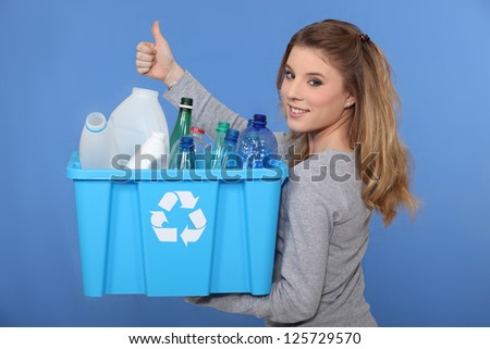 Woman recycling