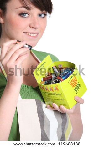 Woman recycling batteries - stock photo