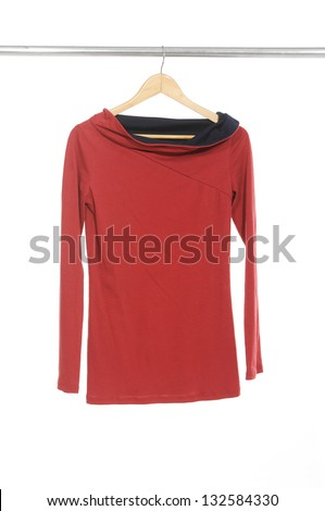 Woman red clothes on a hanger - stock photo