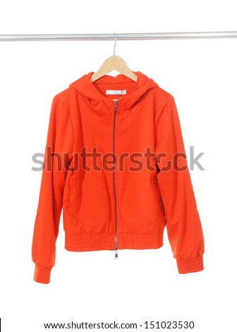 Woman red jacket clothes on a hanger  - stock photo