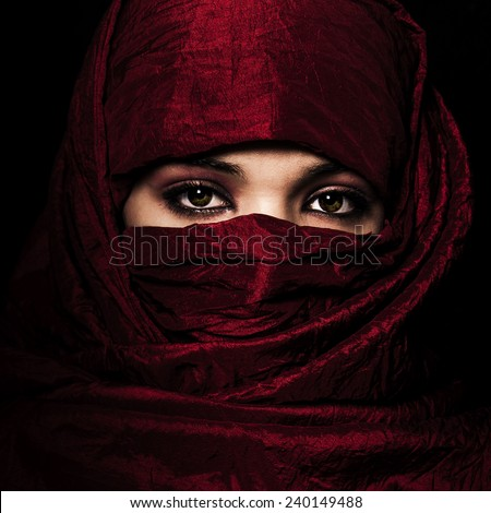 WOMAN RED VEIL - stock photo