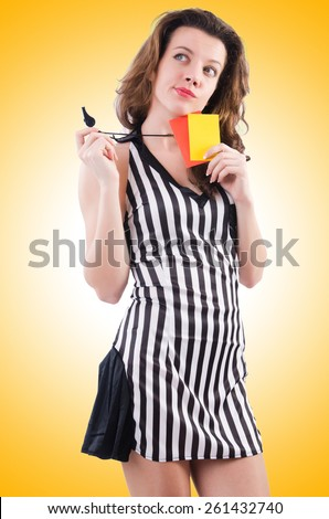 Woman referee with card on white - stock photo