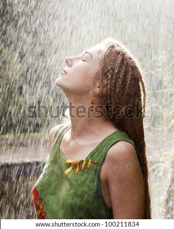 Woman refreshing outdoor in the rain - stock photo