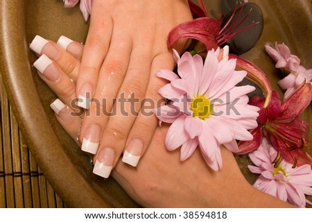 Woman rejuvenating her hands in water - stock photo