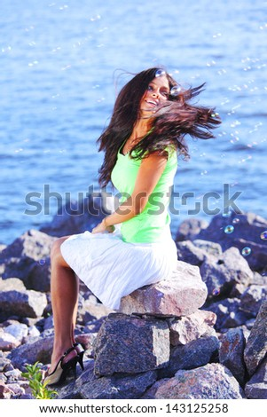 woman relax blue sea and bubbles on background