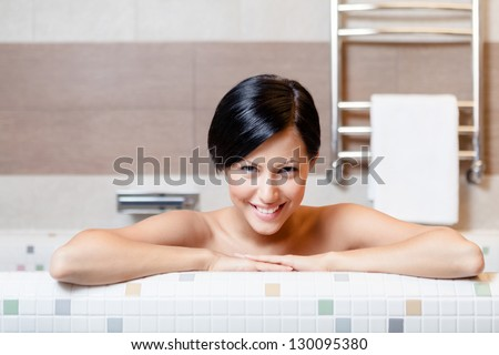 Woman relaxes in bath, hygiene concept - stock photo