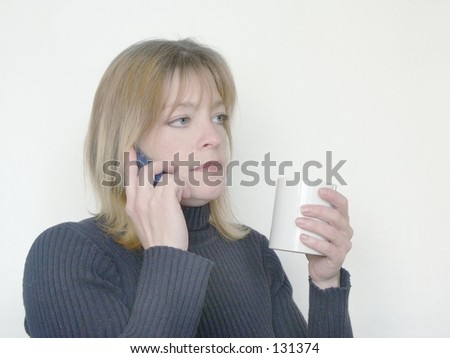 woman relaxing and drinking coffee while talking on phone