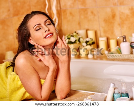 Woman relaxing at home luxury bath. Girl close eyes - stock photo