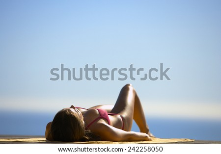 woman  relaxing at swimming pool - stock photo