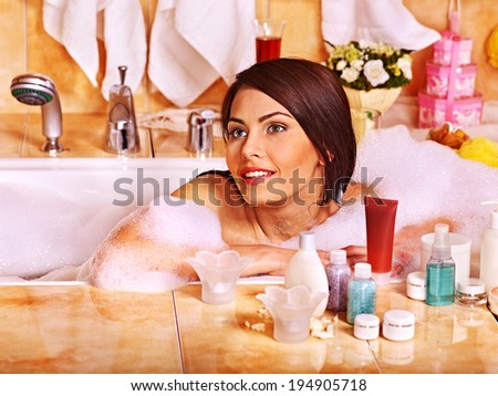 Woman relaxing at water in bubble bath. - stock photo