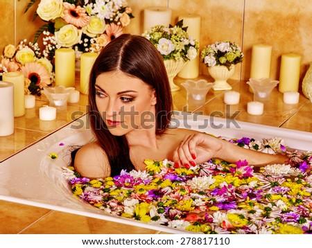 Woman relaxing at wild flowers water spa. - stock photo