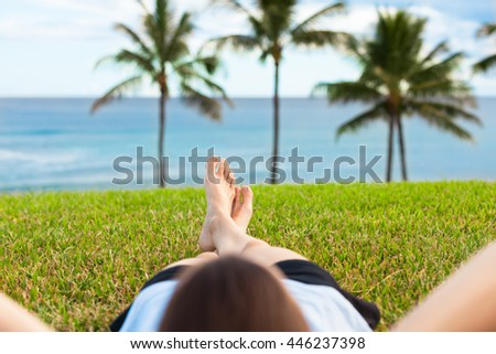 Woman relaxing by the sea side.  - stock photo