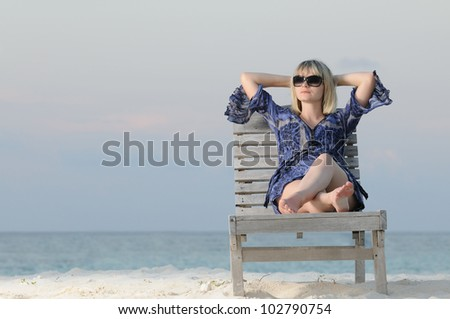 Woman relaxing in a chair, enjoying tranquility - stock photo
