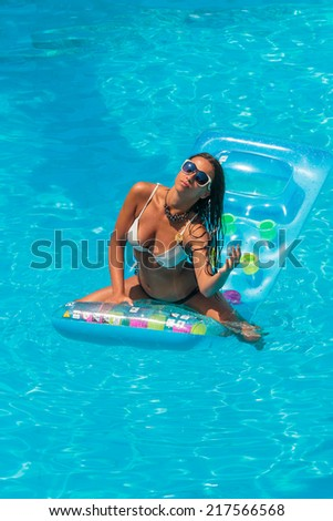 Woman relaxing in a swimming pool