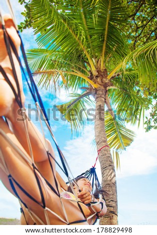 woman relaxing in hammock - stock photo