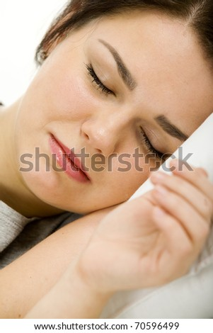 Woman relaxing in her home - stock photo