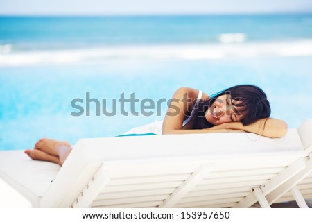 woman relaxing in resort on a sunbed