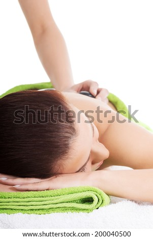 Woman relaxing in spa saloon - beeing massaged