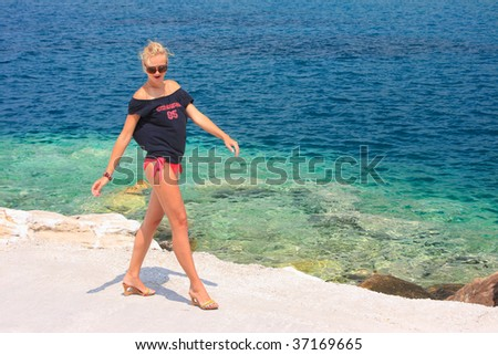 woman relaxing in the afternoon by the sea in Greece