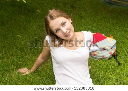 Woman relaxing in the park looking happy and smiling, outdoor - stock photo