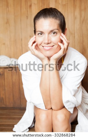 Woman relaxing in the sauna - stock photo