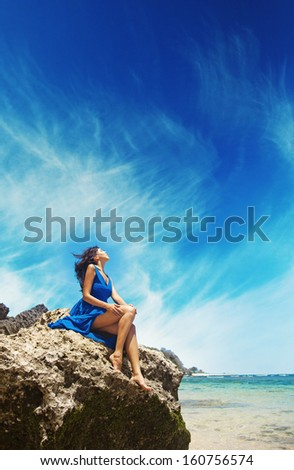 woman relaxing on a stone - stock photo