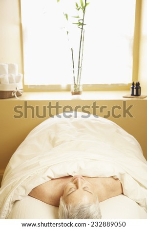 Woman Relaxing on Massage Table - stock photo