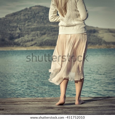 Woman relaxing on pier - stock photo