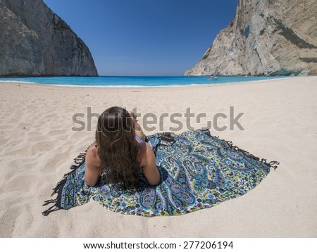 Woman relaxing on the famous Shipwreck Navagio beach in Zakynthos Greece - stock photo