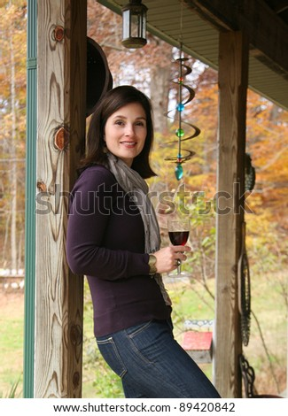 Woman Relaxing Outside with Glass of Red Wine