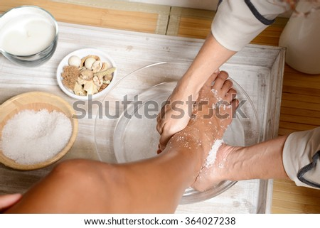 woman Relaxing pedicure and scrub - stock photo