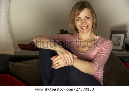 Woman Relaxing Watching Television - stock photo