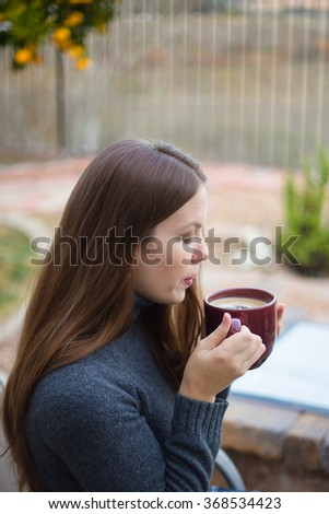Woman Relaxing with Drink