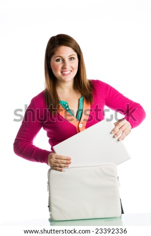 Woman removing a laptop from its case isolated against white