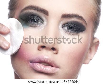 Woman removing make-up - stock photo