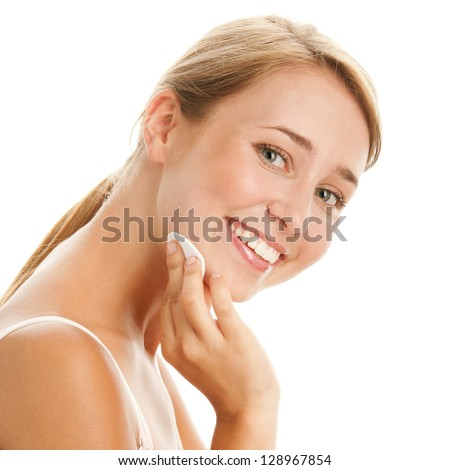 Woman removing makeup - stock photo